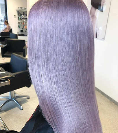 Side profile of woman with long, straight, sleek lilac hair, created using Wella Professionals.