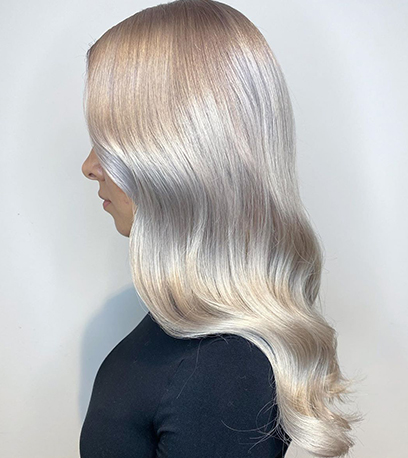 Side of luscious mother of pearl hair, created using Wella Professionals