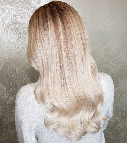 Back of wavy mother of pearl hair, created using Wella Professionals