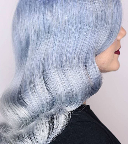 Soft icy blue hair, created using Wella Professionals
