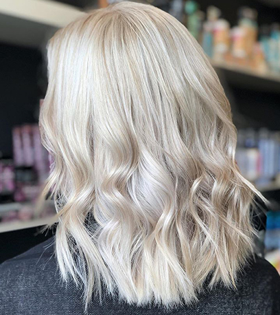 Back of womans head with ice pearl blonde hair