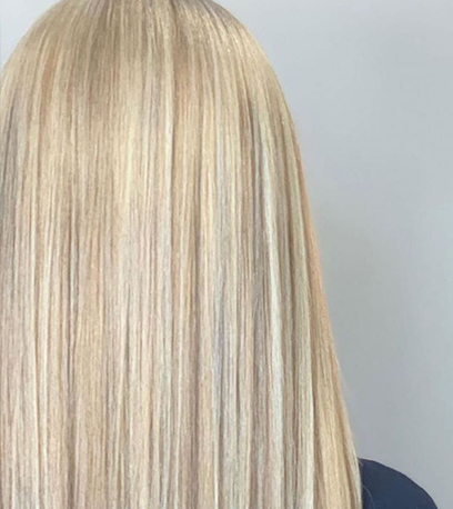 Back of womans head with straight pearl blonde hair