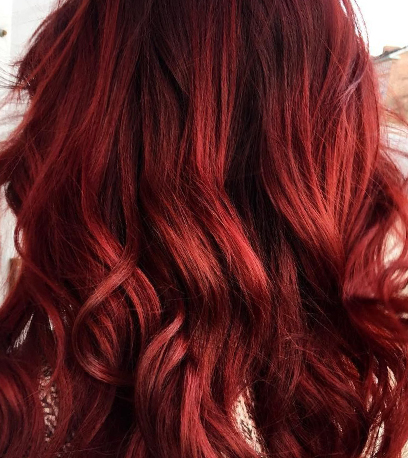 Rich red velvet hair color, created using Wella Professionals