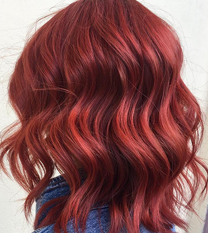 Powdery red hair color, created using Wella Professionals