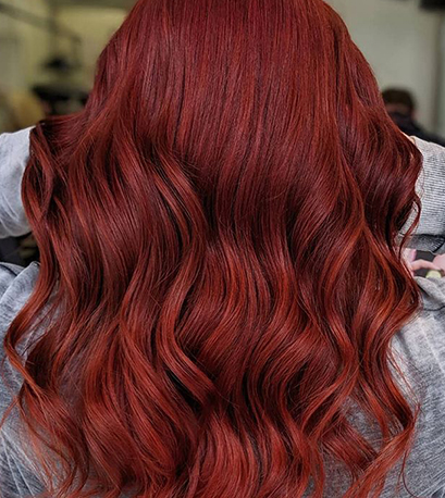 Muted red hair color, created using Wella Professionals