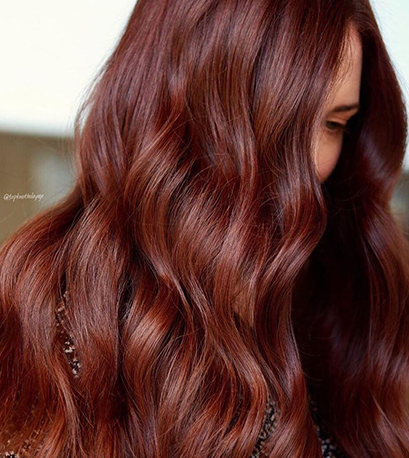 Deep red hair color, created using Wella Professionals