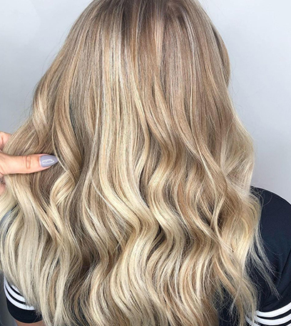 Image of wavey Rooted Baby Blonde Hair, created using Wella Professionals