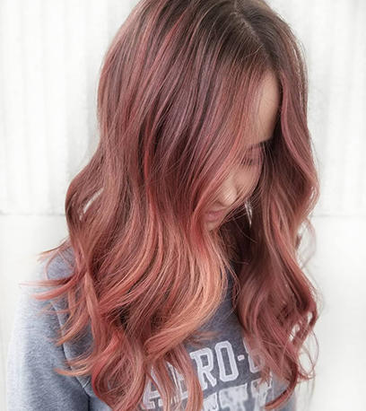 Woman with long wavy rose brown hair using Color Fresh Create