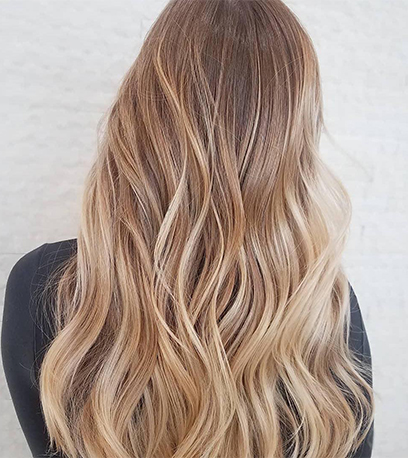 Buttery blonde hair, created using Wella Professionals