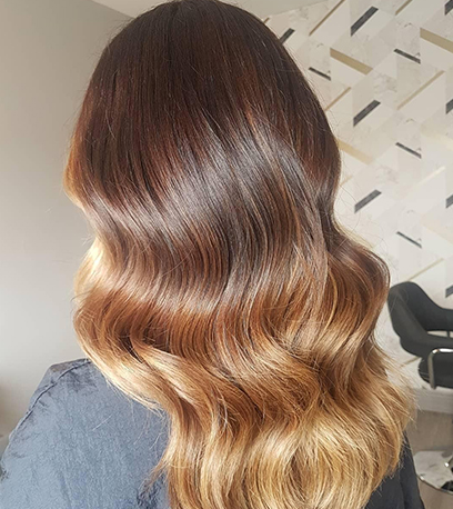 Toffee balayage hair, created using Wella Professionals