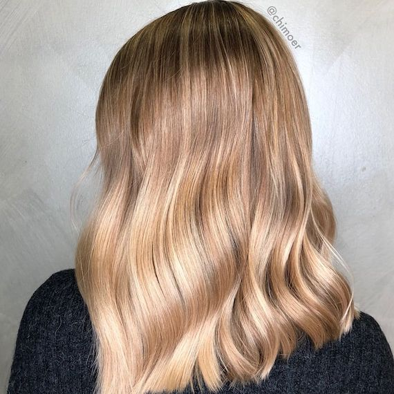 Model with warm blonde hair create with Blondor Freelights and Color Touch